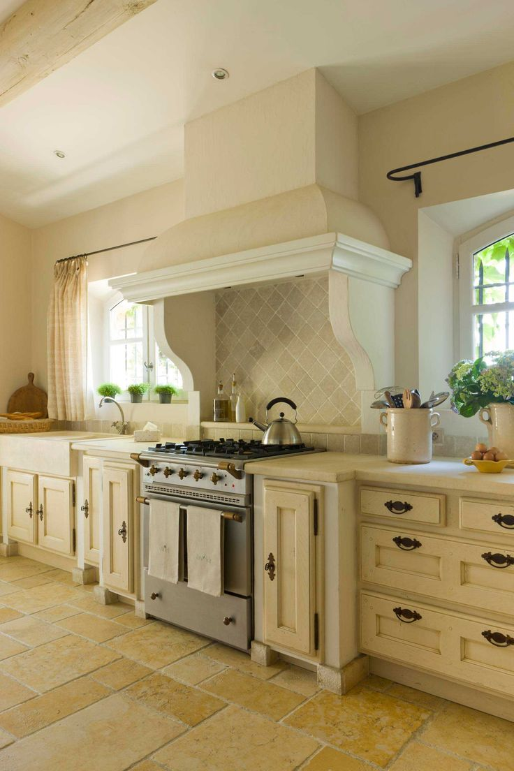Arched windows a range hood with a