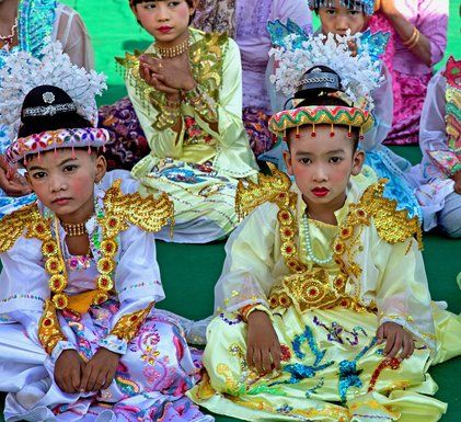 From Amanda Jones: Novice monks wearing topknots are dressed for a ceremony the day before they enter a Buddhist monastery in Myanmar.