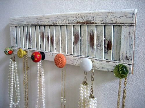 This is a great idea to add some cool knobs to shutters and turn it into a rack for jewelry, belts, etc...actually...the door nobs...are strong enough to hang your coat..personally when i did these i stayed with door nobs..that were a little more together..color wise..just a thought..