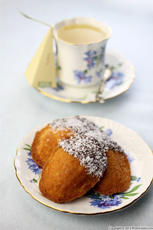 amazing, rich, tender coconut madeleines (made with ground shredded coconut and extract) dipped in chocolate