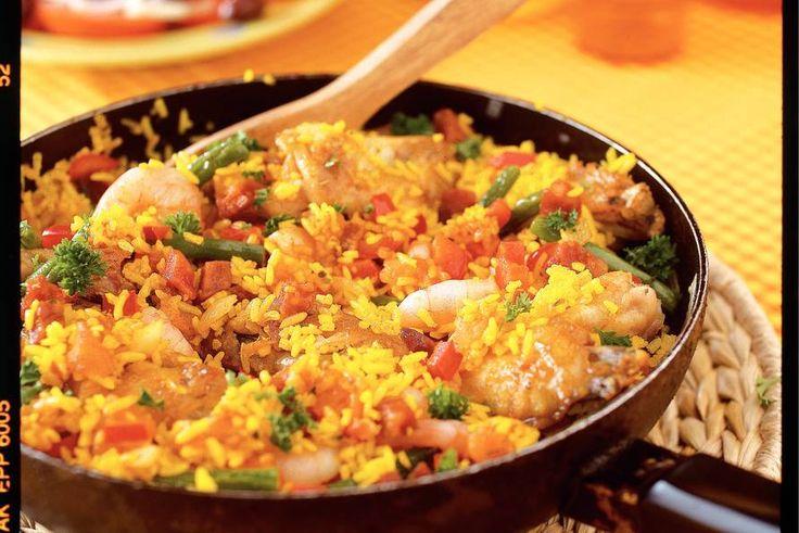 Kijk wat een lekker recept ik heb gevonden op Allerhande! Rijke paella met kip en garnalen