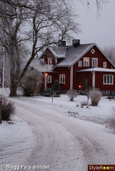 Pretty red house this is so inviting on a snowy day with a warm fire going and candles in every window.
