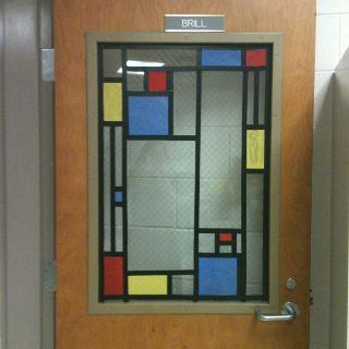 Gotta do this to the art room door this year!  Tissue paper on Laminate of artworks for classroom doors for YAM?