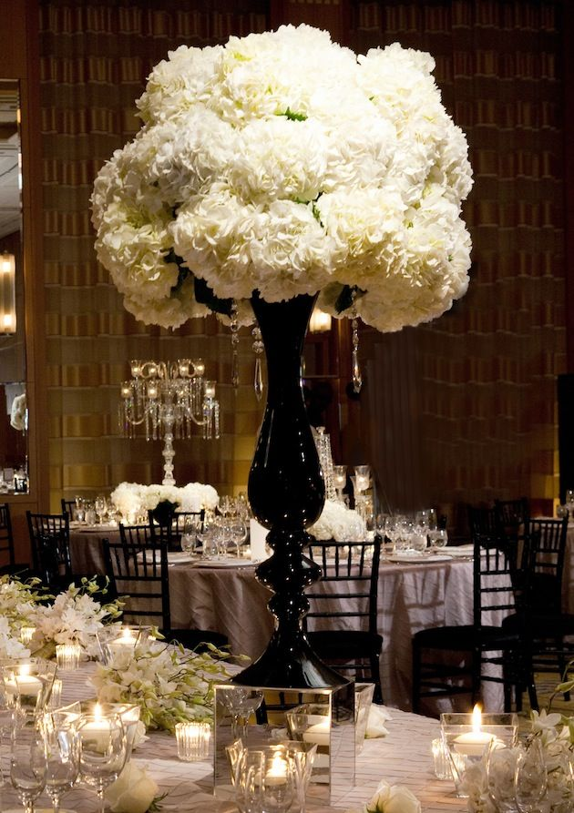 Black Urns Were Situated On Mirrored Stands And Topped With Lush Arrangements Of Ivory Hydrangeas