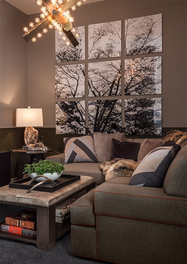 Check out this modern living room décor. Piece together pictures of your favorite landscape and out them together as the center of attention in your living room. This is a great way in setting the tone of your home.