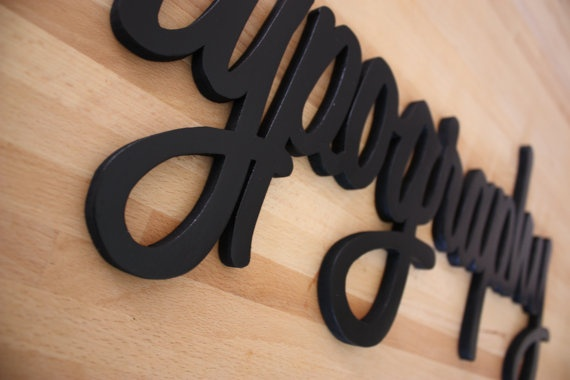 Lo facciamo noi!  Cut from MDF and spray painted with BLACK water based colour, easily hanging on wall.  Cutted with electric sroll saw.  Measures: 58 cm x 25 cm , depth 1cm