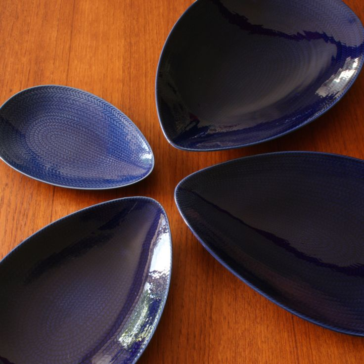 "A set of four ""Blå eld"" drip shaped plates designed by Hertha Bengtsson for Rörstrand Sweden."