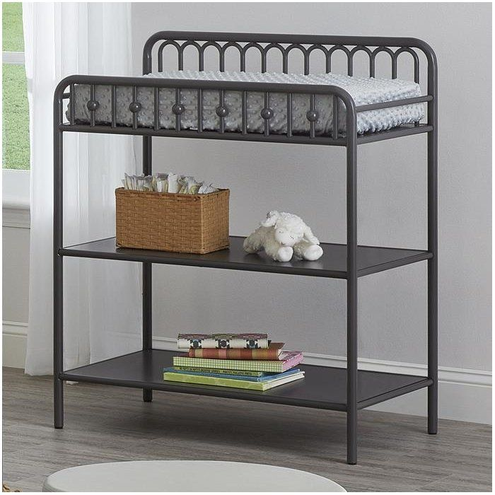 Complementing the Monarch Hill collection, this Victorian-inspired changing table is modeled after period wrought iron furnishings. Arched metal tubes and fine ball castings reflect a period of timeless elegance. The non-toxic painted steel structure is both strong and stable, with a high-quality finish that will resist scuff and scratches. Two storage shelves are designed to hold everything needed for baby changing times. Like all Little Seeds products, this purchase helps support a major…