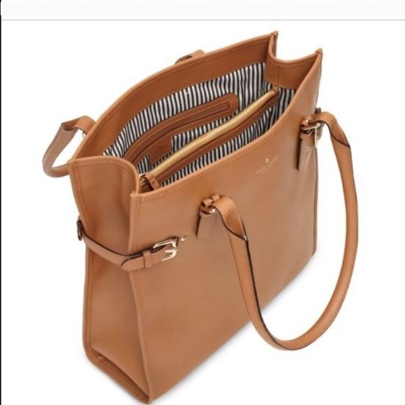 Kate Spade large camel colored leather bag Beautiful camel colored neutral large bag. Fits a laptop or files and is great for a work bag or just an everyday purse. Some slight wear on bottom corners of bag as pictured. kate spade Bags