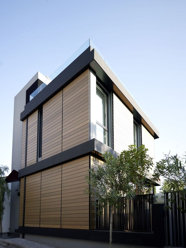 brown-and-black-modern-family-hosue-exterior-paint-color-decorating-ideas-with-wood-wall-cladding-and-iron-fence-design.jpg 1,280×1,706 pixels