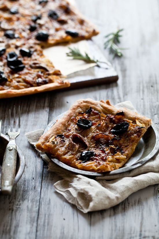 Pissaladiere is a thin crust pizza specialty from the South of France.