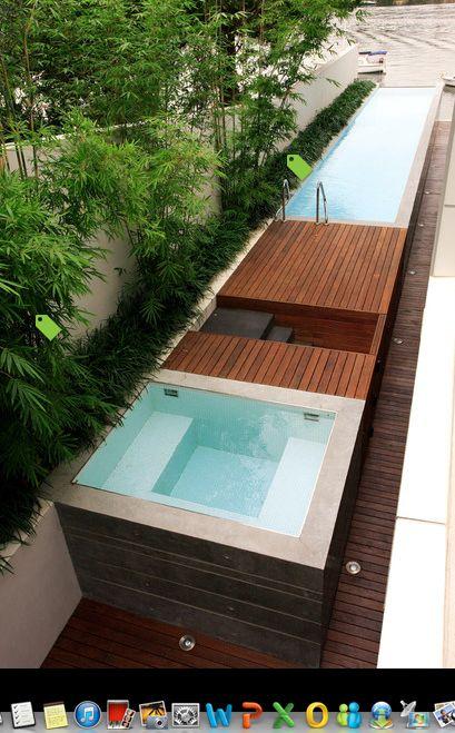 Lap pool w deck in between jacuzzi