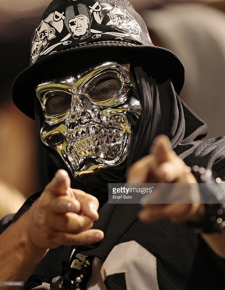 An Oakland Raiders fan tries to intimidate the Dallas Cowboys bench during the fourth quarter of a preseason game on August 9, 2013 at O.co Coliseum in Oakland, California. The Radiers won 19-17.