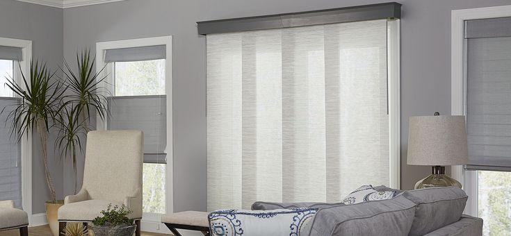 If you need to block glare and harmful UV rays coming in through your sliding glass door, traditional vertical blinds aren't the only choice. The window covering market has developed many modern alternatives that will give you style and function
