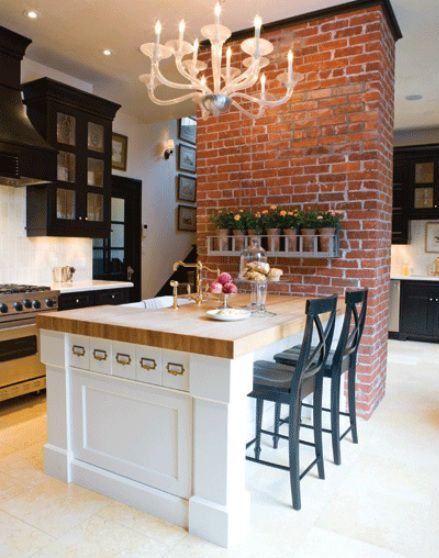 Love the brick, and how it separates the kitchen just a little but is still an open floor plan!