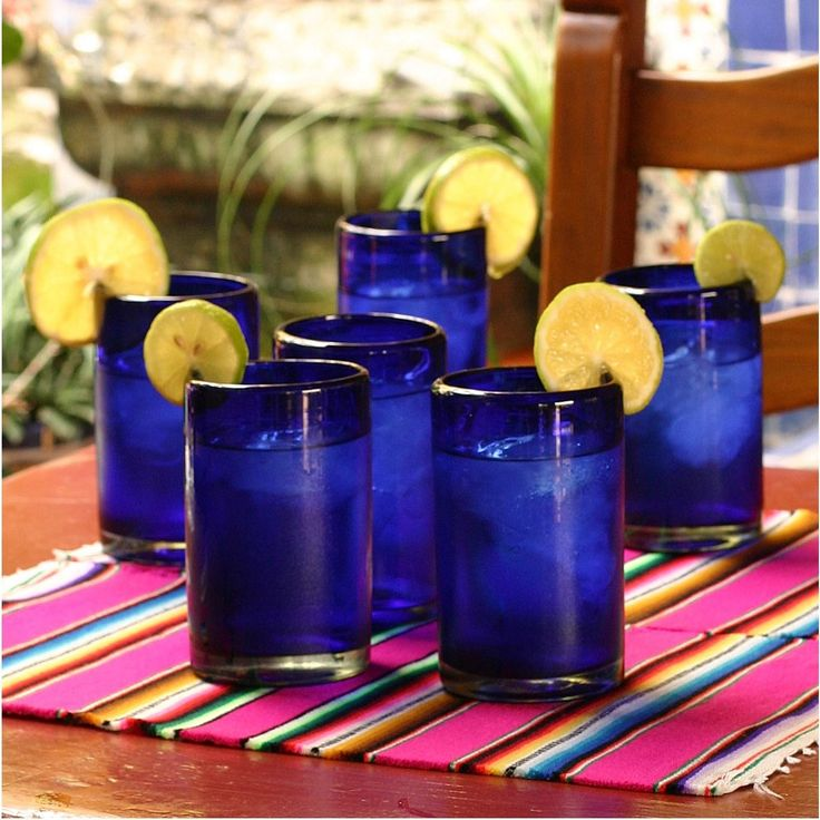 The six beautiful, rich cobalt blue drinking glasses in this set are crafted of blown glass and are perfect for a couple starting a new house together. Each glass holds 14 ounces, and they can be washed on the top rack of the dishwasher.
