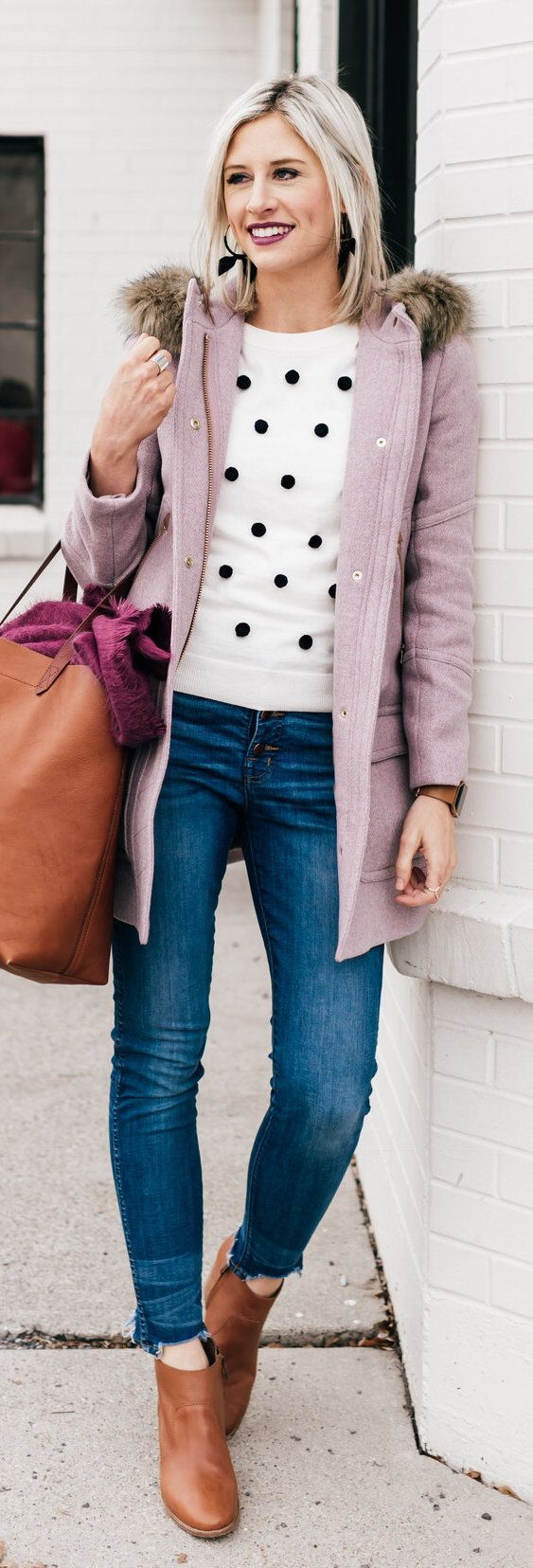 #spring #outfits woman wearing purple parka coat carrying brown tote bag. Pic by @littlemissfearlessblog