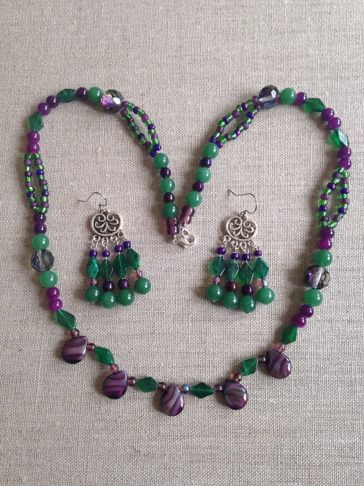 A personal favorite from my Etsy shop https://www.etsy.com/listing/252477155/emerald-green-purple-beaded-necklace
