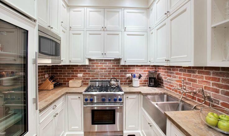 White Kitchen With Red Brick Backsplash