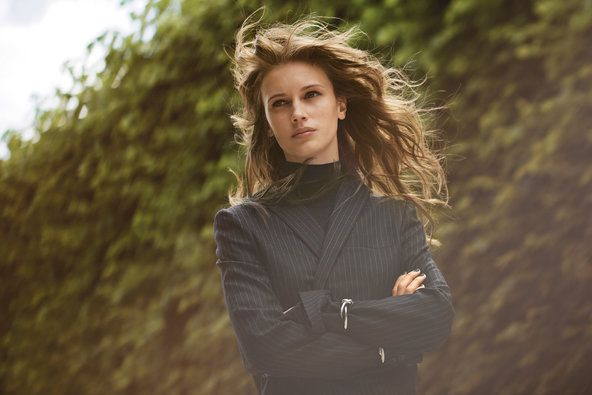 The 23-year-old model turned actress Marine Vacth wears a Salvatore Ferragamo blazer and turtleneck, and Balenciaga cuff.