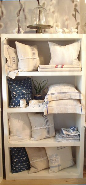 """Fabulous heavy European linens, grain sacks and mattress covers (great for upholstery!) and tea towels. Lovely""""Ballerina"""" pillows with buttons and ruffles made of heavy old sheets, pillows with fronts made of tea towels and backs out of plain antique linen tied closed with old grain sack ties. The Indigo dyed and printed Polka Dot pillows will put a smile on anyone's face. Best of all, this old Linen is virtually indestructible!"""