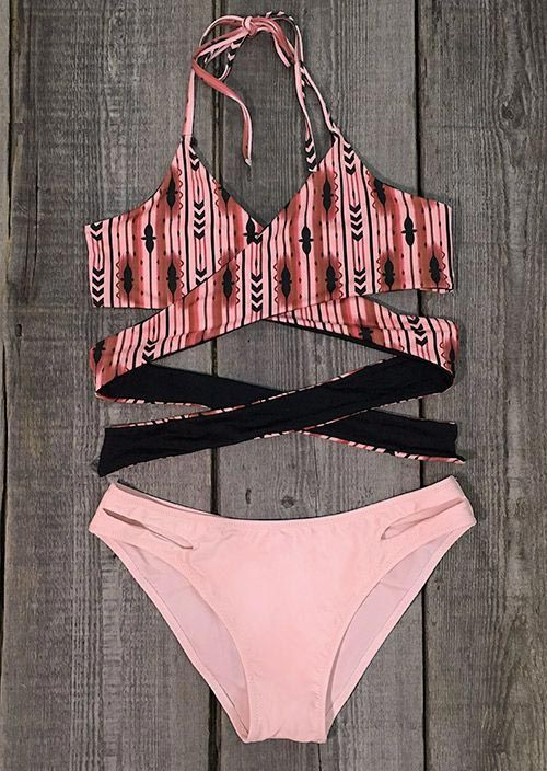 You'll be mine from this moment. Chic halter style meets front cross and high leg cut. It's eye-catching style for you on the cool beach. Just dance, sing and jump with it.