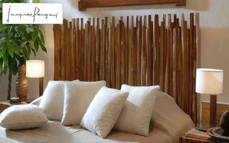 """Bamboo anyone? Glue or tie together with clear fishing line and simply lean against wall behind bed! For added stability, screw a few """"hook screws"""" into the studs of the Headboard wall and hook them under the fishing line, in almost the same fashion that you'd hang a canvas art piece that has a horizontal piece of wire attached to the backside!"""