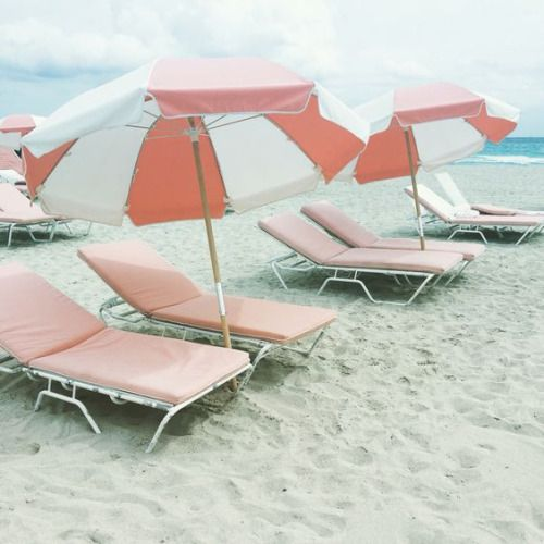 beach coral and peachy pink lounge chair and umbrellas
