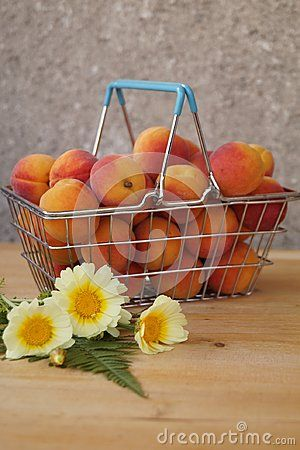 Basket of apricots and yellow flowers