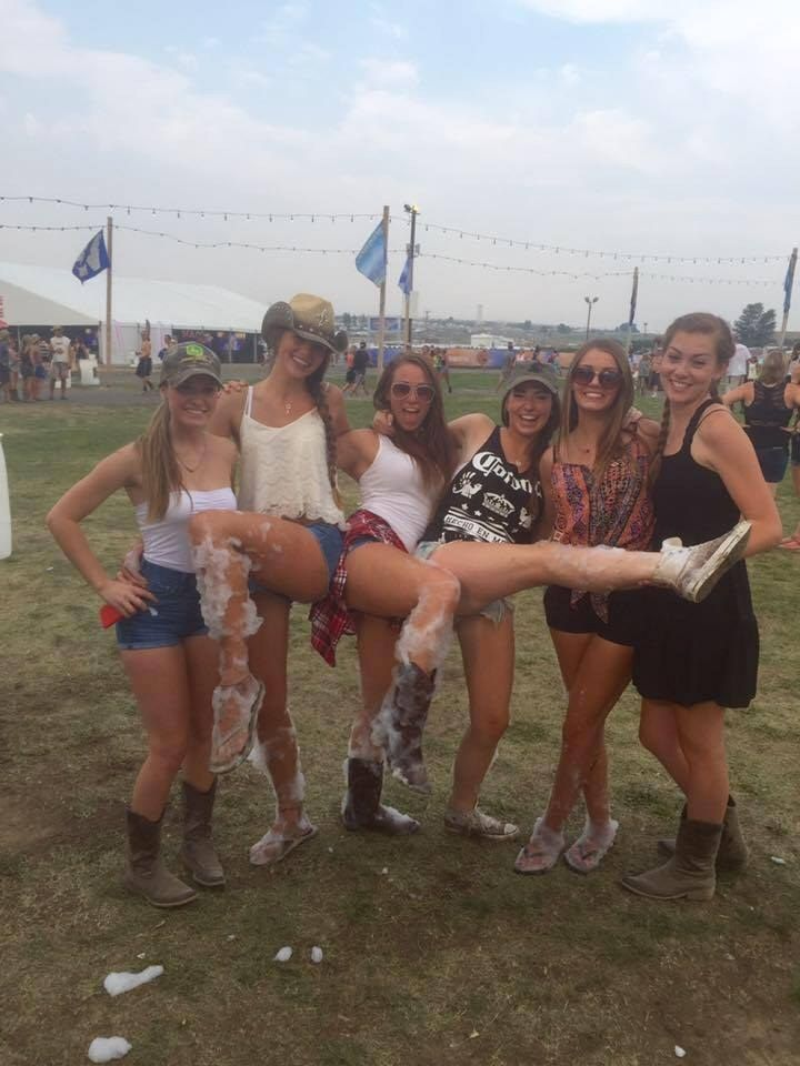 These young ladies showing off their legs covered in foam.