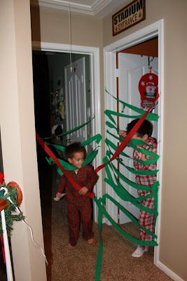 i wrapped the boy's doors with crepe paper to bust through christmas morn.