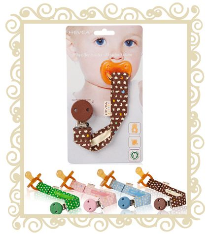 Hevea Pacifier Holder - Strap  Pacifier holder in 100% organic cotton with rubber tree clips to clip onto clothing. This pacifier holder is made of organic cotton, and the pattern Hevea designs is printed with soy ink, which can be washed. On the back you can write the child's name, very useful for identification for example in the Day-care.  $15.95