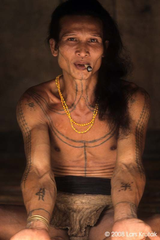 Aman Ipai has many tattoos, including a crucifix-like crab tattooed on his right forearm. Although he is not a shaman, crabs are invoked by Mentawai shamans during healing and other rites because they are believed to never die (e.g., they can discard their old bodies and obtain new ones or regenerate severed limbs).
