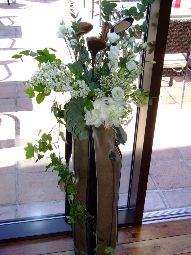 Golf themed decor by Sweetpea and Ivy. Grass, Golf Balls. Golf Tee's, Vintage Golf Bag, Vintage Golf Shoes, Driftwood Planter Floral Centre Peices.