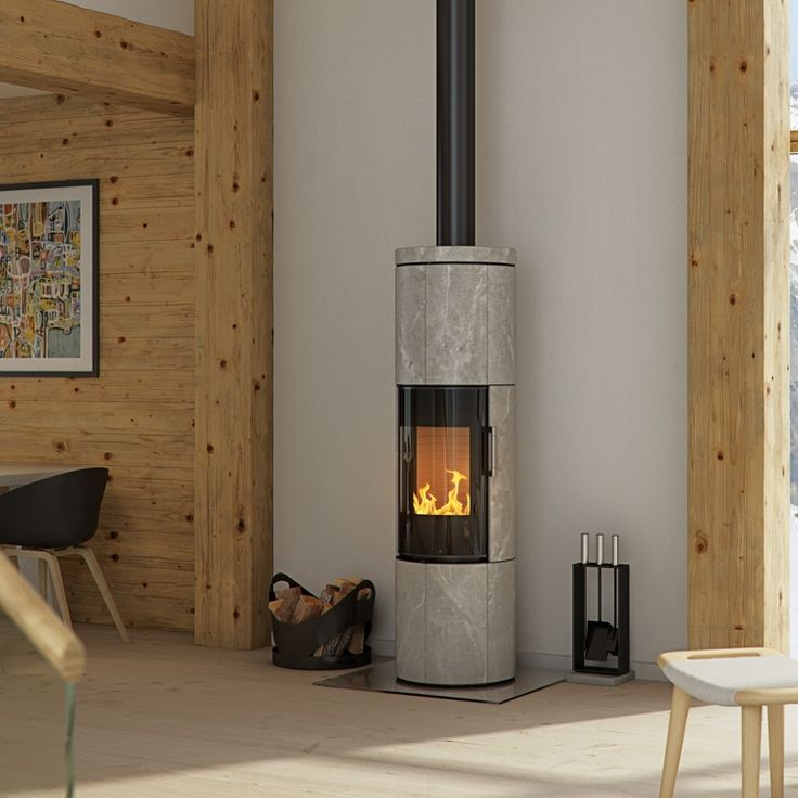Juno is a state-of-the-art and almost sculptural wood-burning stove, where the beautifully rounded, light natural stones stand in striking contrast to the fire and the shiny glass and steel.  #kernowfires #wadebridge #redruth #cornwall #rais #wood #burning #stove #fire #heat #storage #natural #stone #glass #steel #contrast #modern #contemporary #design