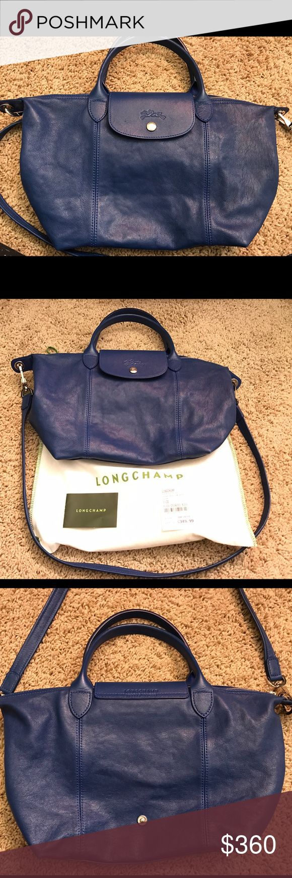 "Longchamp blue le pliage cuir SOLD OUT! Purchased at century 21 department store, I still keep the c21 price tag. The original price is $495. Gently used for a few times, it's in excellent condition, no visible wear and tear. This is a multi-functional crossbody bag and it's super lightweight. supple grained lambskin leather, zip top closure with outer snap tap, dual rolled handles, detachable shoulder strap, embossed logo details, foldable construction. 9 3/4"" L x 9"" H x 6 1/4"" W Longchamp…"