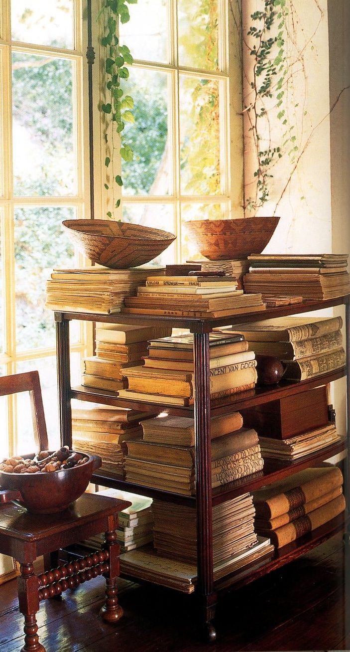 A different way to display books...    Necessity is the mother of invention...when your shelves are over flowing....try this and also the floor...
