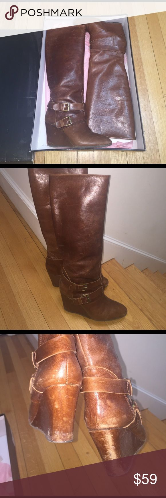 Steven by Steve Madden Boots Cognac buckle knee high wedge boots by Steven By Steve Madden. Very good condition!! Discoloration on back of heel from driving but can probably be restored with conditioning of leather. Steven by Steve Madden Shoes Heeled Boots