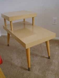 1950's blonde 2 tier side/end table. I remember having to dust those.  Personally I never did like the color.