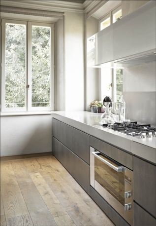 love the rustic floors with the contemporary finishes.  caesar stone countertops work well and adds the contemporary finish