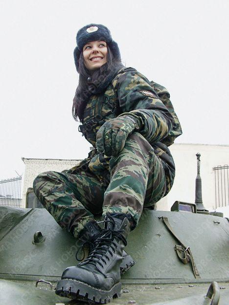 Russian girl. Military. Tank.