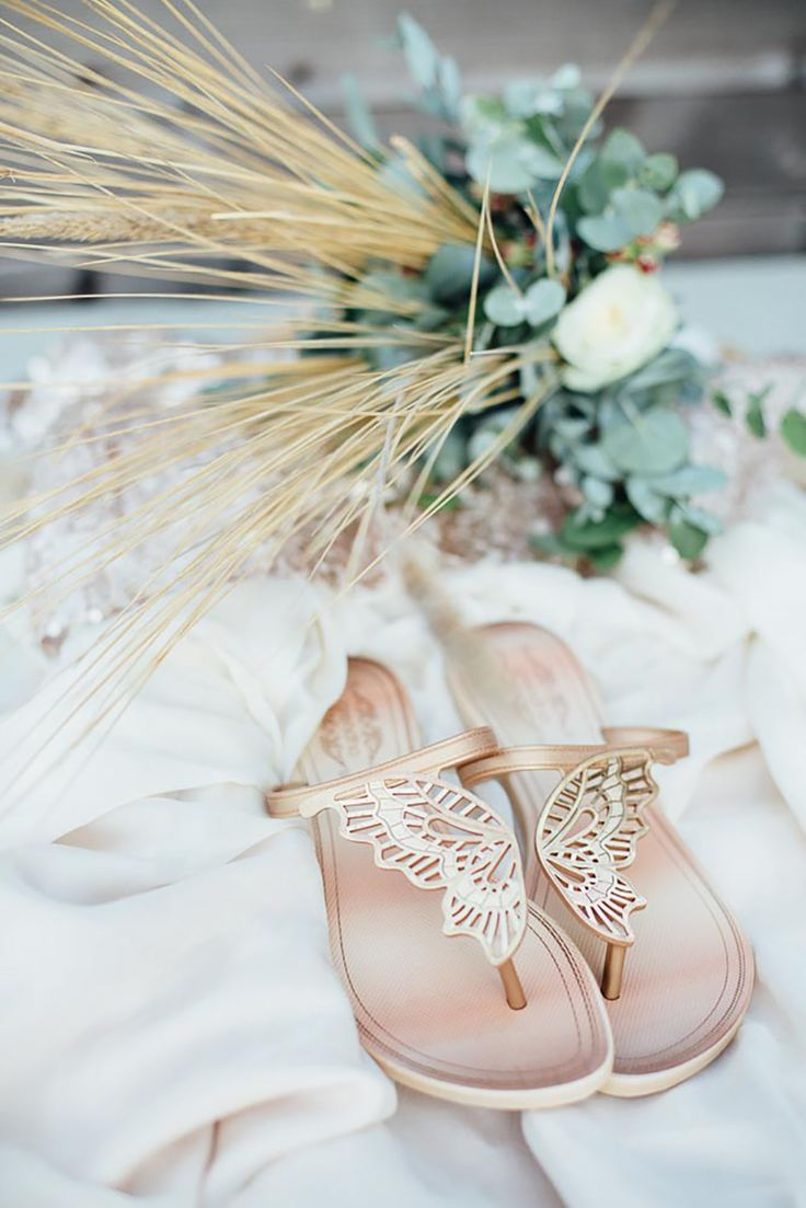 11 Unique Boho Wedding Themes - Gold butterfly wedding sandals