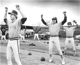 Muskies warming up.  Muskies warming up, 1983  The Madison Muskies warm up in the parking lot before a game with the Wausau Timbers, April 13, 1983. Canseco is second from right. Source: Image courtesy of Ed Stein; copyright Wisconsin State Journal; reprinted with permission