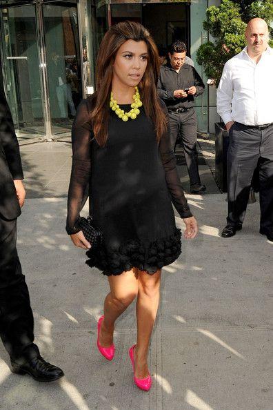 Kourtney Kardashian Little Black Dress - Kourtney Kardashian wore her long-sleeve LBD with bright neon accessories.
