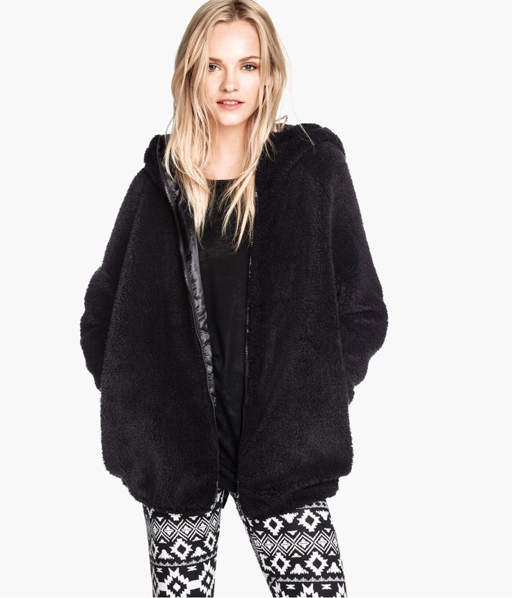 Cuddle up in this fluffy black jacket with lined hood &amp side