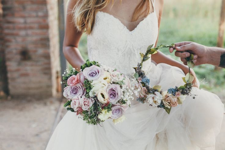 Romantic floral wedding bouquet made with roses & lisianthus + handmade flower crown both by @fioriricci