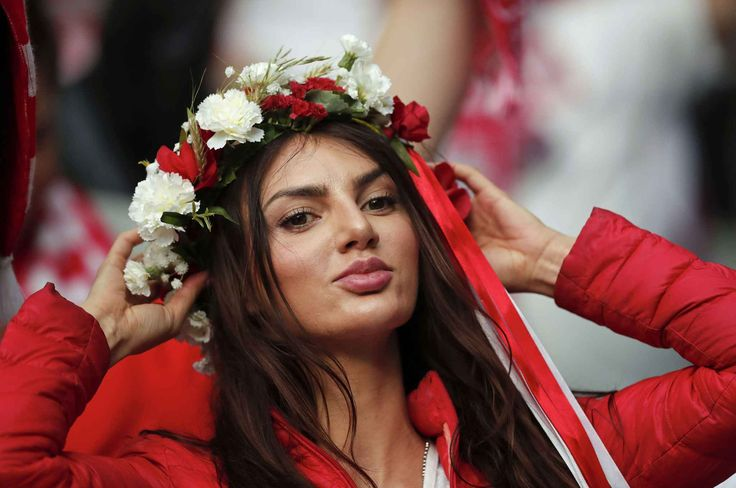 A Poland team's supporter waits for the start of the Euro 2016 Group C soccer match between Germany and Poland at the Stade de France in Saint-Denis, north of Paris, France, Thursday, June 16, 2016. (AP Photo/Christophe Ena)/HAS156/719408589601/1606162056