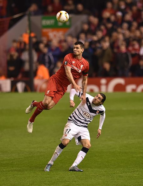 THE SUN OUT THE SUN ON SUNDAY OUT Dejan Lovren of Liverpool competes with Enzo Crivelli of FC Girondins de Bordeaux during the UEFA Europa League...