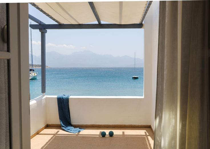 The view from the art Bungalow Waterfront Balcony at Minos Beach Hotel in Crete.
