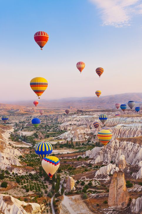 Soar through the skies of Cappadocia on a magical hot-air balloon tour in #Turkey
